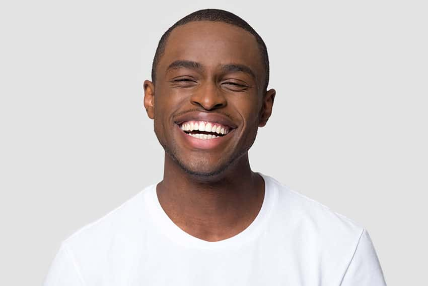 young man with big, wide smile